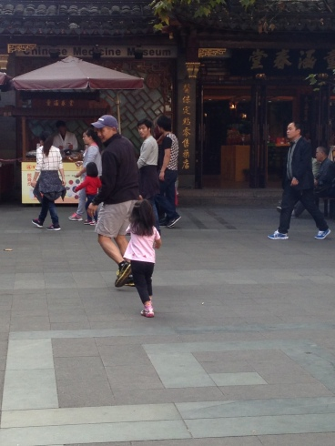 Chasing Daddy around temple in Shanghai